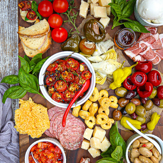 Roasted cherry tomatoes are the star of this Italian grazing board.